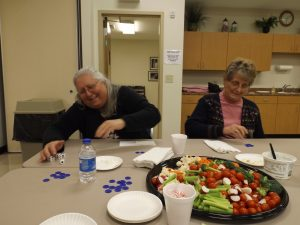 Photo contributed  Homemakers Debra Caldwell and Anna Carpenter enjoy Game Night.