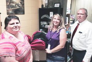 From left, Lake Herrington KCCD President Kristi Wellsman, Boyle County Schools Family Resource Director Liz Gardner, and Northpoint Training Center Warden Don Bottom.