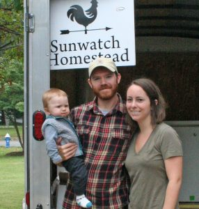 kendra Peek/kendra.peek@amnews.com Tyler Greene, with his wife Brittney and their son Fox, at the Farmer's Market on Saturday.