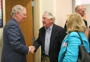 Kendra Peek/kendra.peek@amnews.com Mitch McConnell talks to Basil and Betty Turbyfill after a legislative update at the Boyle County Extension Office.