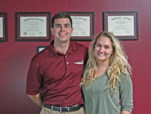 Kendra Peek/kendra.peek@amnews.com Wesley Carter, along with his girlfriend and coworker, Ariel Darnell, at the Harrodsburg campus of Campbellsville College.