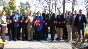 Kerry Steinhofer/kerry.steinhofer@amnews.com Morning Pointe representatives and local officials help cut a ribbon for the grand opening of the senior living facility Tuesday.