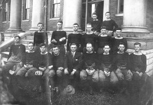 1916 K.S.D. Varsity Football Team -- Front row: Harley Crouch, Pearl Webb, Clyde Butcher, Geo. Barron. Coach Max Marcosson, Ashland Martin, Gus Boltz, Burchell Smith, Frank Ewing. Back Row: Cecil Brown, Harry Smith, William Sturgill, Vandon Manning, Robert Lowry, Harry Parrish.  Top Row: Herbert Farquhar and Arthur Riley.