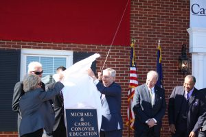 The Conover's and Senator Mitch McConnell revealed the plaque that will placed inside the Conover Education Center.