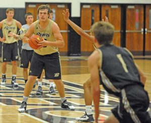 Matt Overing/matthew.overing@amnews.com Boyle County junior Will Bramel makes a pass during practice. Bramel will be the starting center for the Rebels this season after years practicing behind Colton Elkins.