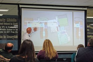 Kendra Peek/kendra.peek@amnews.com Boyle County Superintendent Mike LaFavers explains the functionality of the media center and collaboration spaces in the artist rendering of the new Boyle County Middle School, slated to open in the 2018-2019 school year.