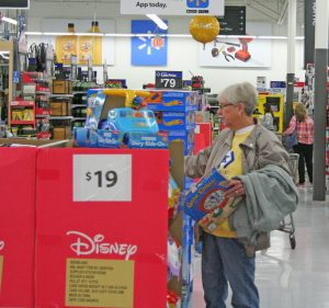 Kendra Peek/kendra.peek@amnews.com Dora Hicks of Hustonville shops at Walmart. Hicks said she had started about 7 a.m., hoping to miss the early crowds.