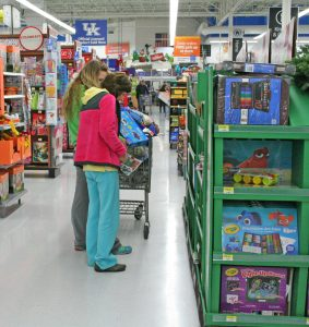 Kendra Peek/kendra.peek@amnews.com Annette Hall and Brittany Nye shop Friday morning at Walmart. The two said they started their shopping at about 7 a.m. and had been Black Friday shopping for the last few years.