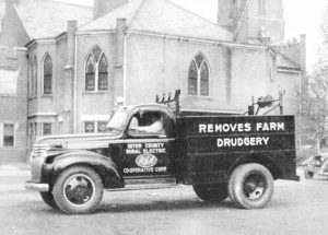An early Inter-County Rural Electric Cooperative Corp. truck advertises what it does for farmers.