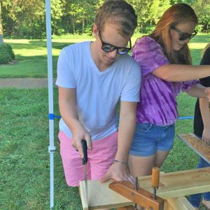 Photo submitted  Tyler Mattingly and Lyndsey Bell try their hands at carpentry, 1800's style during an educational day at the Abraham Lincoln Birthplace National Monument in Hodgenville.