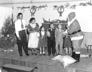 A surprise visit from Santa! In the 1940s, Margaret Marshall and James Royster, teachers in the KSD Colored Department, produced several plays starring their young students. In this scene from a 1949 Christmas play, from left, Richard Bartlett, Henrietta Duncan, Marilyn Allen, George Rawlings, Joseph Jackson and Richard Dorsey meet Santa.