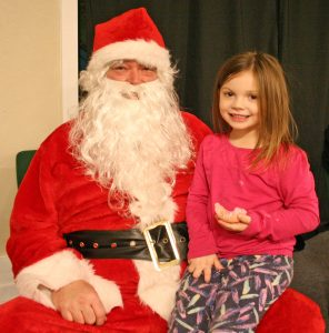 """Kendra Peek/kendra.peek@amnews.com Macy Caruso with """"Santa,"""" Bruce Coffman."""