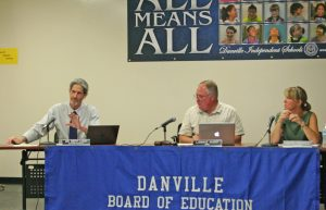 Kendra Peek/kendra.peek@amnews.com Chairperson Lonnie Harp, center, and Vice Chair Kate Graves, right, will complete their terms at the end of this year. They are seen in his photo from the August meeting of the Danville Board of Education.