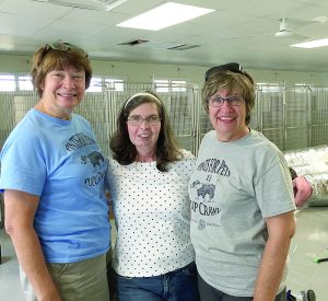 "(Photo contributed) ""I was able to sneak a photo of us today,"" Kathy Nelsen said, pictured here in center with Bettie Poland, left, and and Janet Martin inside of the new adoption facility."