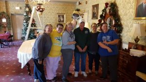 A few of the many alumni and Jacobs Hall Museum staff members who devote hours to decorating, were at work on a Saturday in late November. From left: Valerie Wise, Regina Gibbs, Barbie Harris, Roger McCowan, Rhonda Smallwood and Krista Helton.