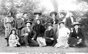 In October and November staff and students enjoyed going to the knobs to gather nuts. They usually returned with bushels and bushels of chestnuts, walnuts and hickory nuts. This 1903 nutting included Mr. and Mrs. Wilson, Mr. and Mrs. Reed. Miss Stephens and Mrs. Marcosson. Others, including the children, are not identified.