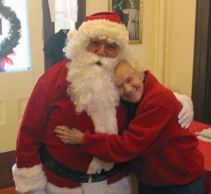 Last year Santa (Gary Crase) shared a hug with Beulah Hester.