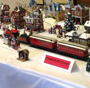 Joe Buschmann and Archie Harris operate two Christmas village trains in Jacobs Hall this month. This is a glimpse of the Buschmann village.