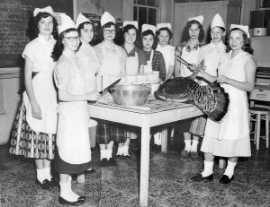 In the mid-1950s Ruth and Robert Mynear's father gave a live turkey to Dr. Madison Lee, KSD's Superintendent. Dr. Lee, seeing a unique teaching opportunity, gave the turkey to the girls' vocational department. The girls prepared a huge turkey dinner from scratch for the administration. Pictured from left to right: Mary Smotherman, Dola Russell, Judy Hillard, Loretta Halbert, Charlotte Madden, Mary Rowe, Amelia Waid, Velma Strong, Leila Smith, and Ruth Mynear.
