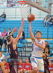 Matt Overing/matthew.overing@amnews.com Casey County's Breece Hayes goes to the basket in Thursday's game.