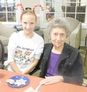 Alli Stewart from Bethel Baptist Church, and and Norma Caldwell, Morning Pointe of Danville resident, decorate Christmas cookies together.