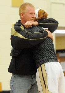Matt Overing/matthew.overing@amnews.com Jim Harris hugs his daughter, Emmie, on Senior Night.