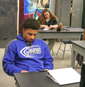 Kendra Peek/kendra.peek@amnews.com Christian Hill, left, and Emily Thomas, right, work on their projects during Shelly Stinnett's art class.