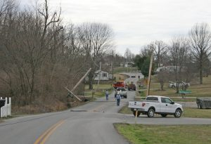 Kendra Peek/kendra.peek@amnews.com Boyle County Fire Fighters block Alum Springs road as InterCounty Energy crews work to remove the downed lines and cut the power after a tractor trailer took out four poles, including a transformer, on Tuesday.