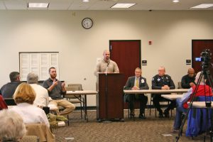 Kendra Peek/kendra.peek@amnews.com Boyle K9 Deputy Casey McCoy, center, speaks to the group at the police and community forum on Thursday night. He was joined, from left, by sign language interpreter James Overing, moderator Burt Piper, Danville Asst. Chief Robert Estill, and Danville Police Chief Tony Gray.