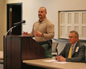 Kendra Peek/kendra.peek@amnews.com Boyle County K9 Officer Casey McCoy speaks at the police and community forum on Thursday night. McCoy filled in for Sheriff Derek Robbins, who was unable to attend. Also pictured, Burt Piper, moderator, of the event.