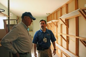 Kendra Peek/kendra.peek@amnews.com Magistrate Phil Sammons and Deputy Jailer Brian Wofford look at the closet, which will be used to store clothing and other items for the participants of Shepherd's House.