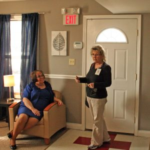 Kendra Peek/kendra.peek@amnews.com Patsy Harmon, office manager of Shepherd's House, left, and Lisa Rousey, right, during the open house on Friday.