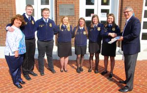 Ben Kleppinger/ben.kleppinger@amnews.com Boyle County Judge-Executive Harold McKinney, far right, and Boyle County Clerk Trille Bottom, far left, pose for a photo with members of Boyle County FFA from left, Tristan Harp, Blake Carpenter, Michaela Carpenter, Reporter Cheyanne Maupin, Treasurer Karli Graves and President Cori Quesenberry.