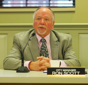 Ben Kleppinger/ben.kleppinger@amnews.com Danville City Manager Ron Scott speaks with representatives from Harshaw Trane Wednesday morning during a special called meeting of Danville City Commission.