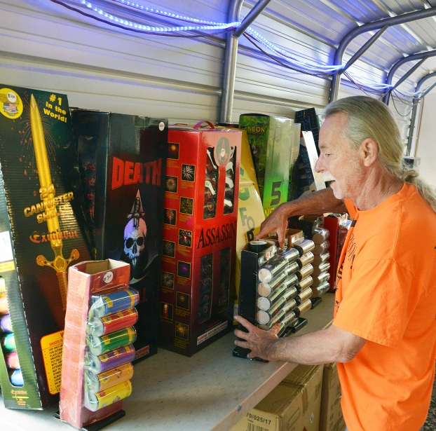 Ray Boone, owner of Fourth Street Fireworks and Little Sign Shoppe, keeps a supply of large artillary shells in his fireworks booth. He said safety protocol is very important when enjoying backyard fireworks. (Photo by Robin Hart)